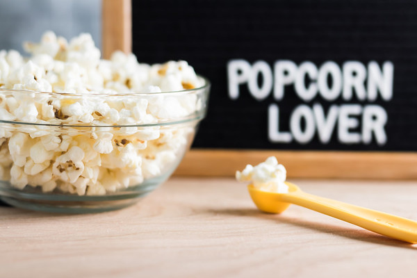 Popcorn Lover Text on a Letterboard with a Bowl of Popcorn