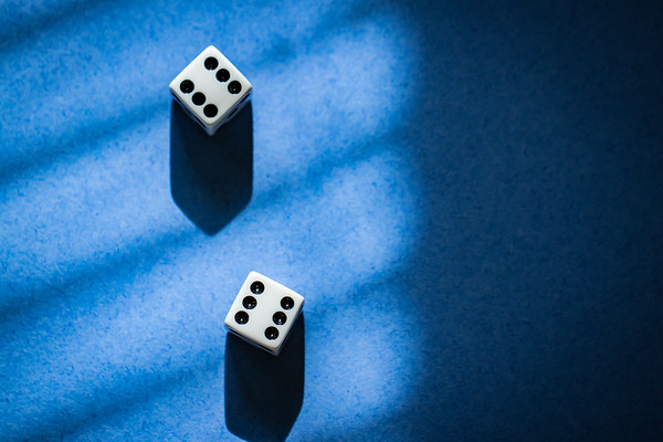 Overhead dice on a Blue Background