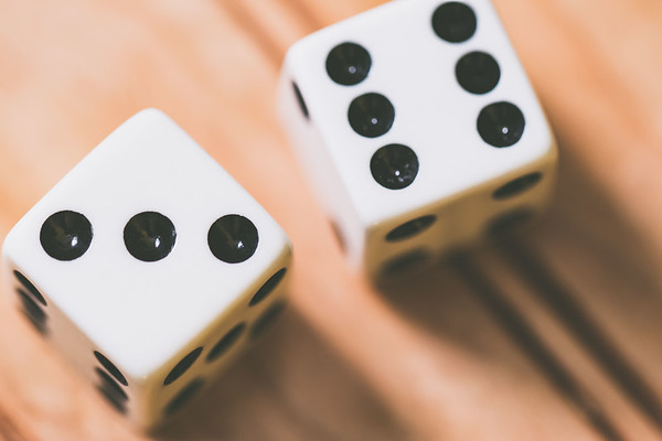 Dice on a Wood Background