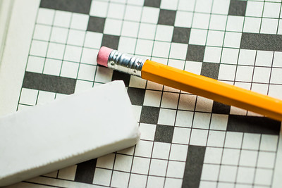 Overhead Angle of a Pencil and Eraser on Top of a Crossword Puzzle