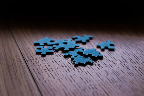 Puzzle Pieces on Wood