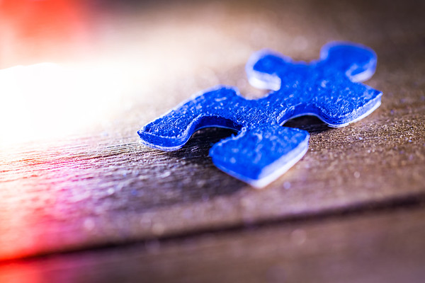 Blue Puzzle Piece on Wood