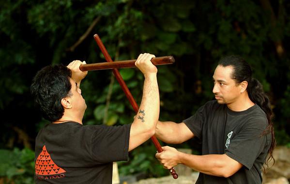 lua students practice an attack:block technique with ko'o ko'o (15)