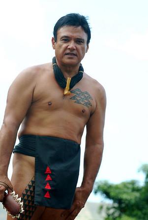 lua warrior holding lei-o-mano (shark's lei) weapon