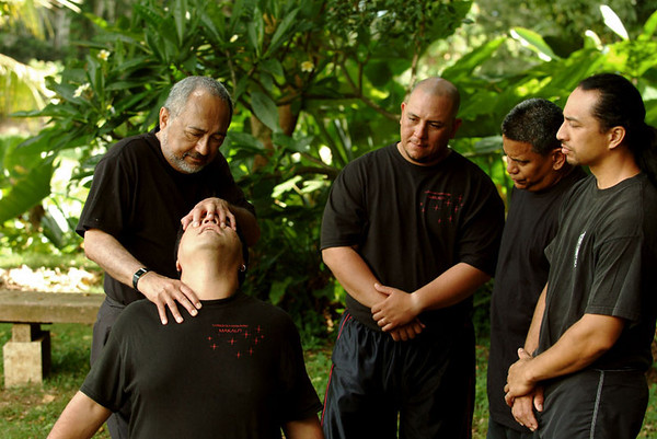 Olohe (lua master or teacher) demonstrates ho na maka (face rip, or eye gauge) 85