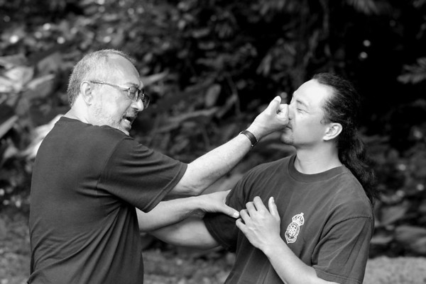 Olohe (lua master or teacher) demonstrates ka ihu a ka la (literally, nose pink) 60