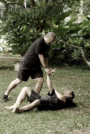 Olohe (lua master or teacher) demonstrating a wrist break 68