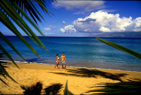 A honeymoon couple at Napili Beach, Maui.