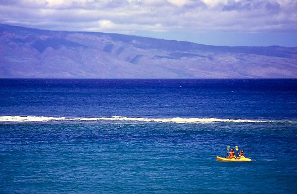 Kayaking off Kapalua, Maui. In the background, Molokai.