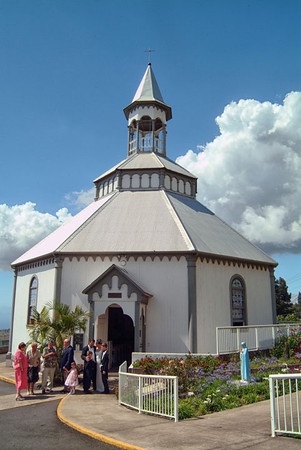 A wedding in progress at Maui's unique hexagonal Holy Ghost Church