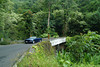 A car drives over one of the many bridges on the scenic Road to Hana, Maui