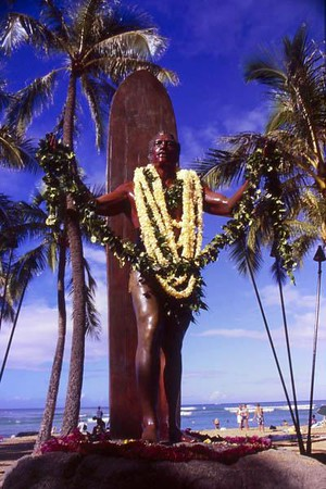 Duke Kahanamoku statue draped with fresh lei, Waikiki Beach