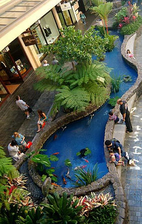 Shoppers relax around one of the koi ponds at Ala Moana Center, Honolulu, Oahu.