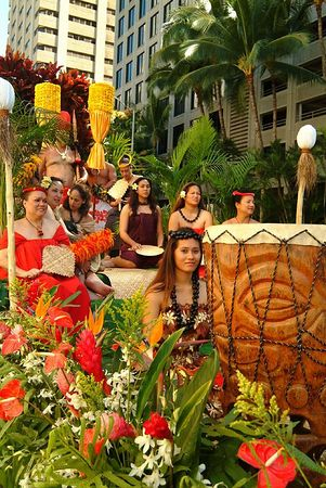 Kamehameha Day Parade floral float featuring Hawaiian royalty
