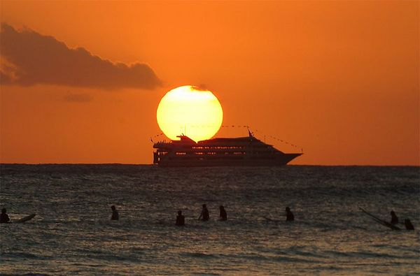 cruise ship off Waikiki Beach at sunset