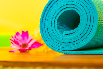 Blue Yoga Mat Against a Colorful Background