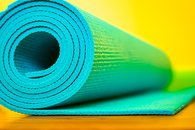 Blue Yoga Mat on a Yellow Background