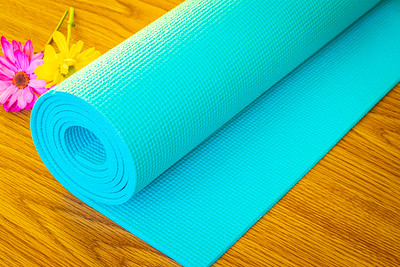 Blue Yoga Mat on a Wood Table