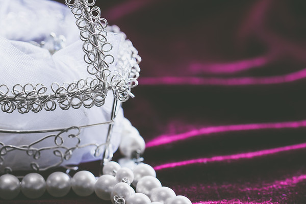 Ring Basket and Pearls on a Velvet Fabric