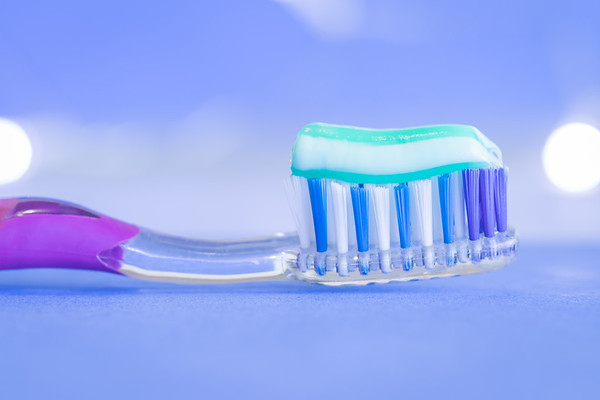 Toothbrush on a Blue Background