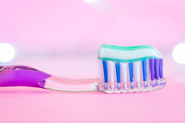 Toothbrush on a Pink Background