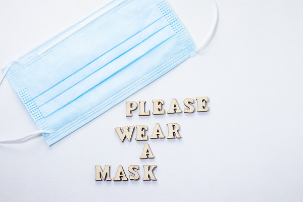 Blue Face Mask and Text on a White Background