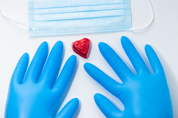 Overhead View of Blue Latex Gloves and Doctor's Equipment on a White Background