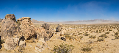 Panoramic View of Stones in Sand Desert
