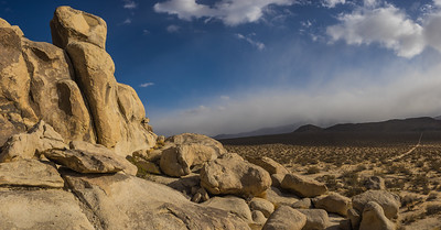 Desert Boulders and Approaching Storm