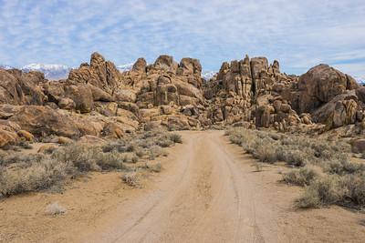 Dirt Road Toward Boulders