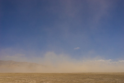 Sand Blows over Flat Desert