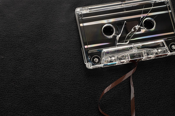 Broken Cassette Tape on a Black Background