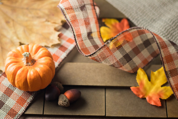 Overhead Angle of Autumn Decorations on a Wooden Table