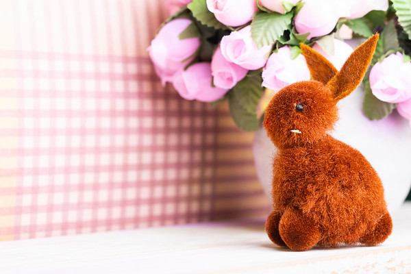 Brown Easter Bunny with Pink Flowers on a Pink Background