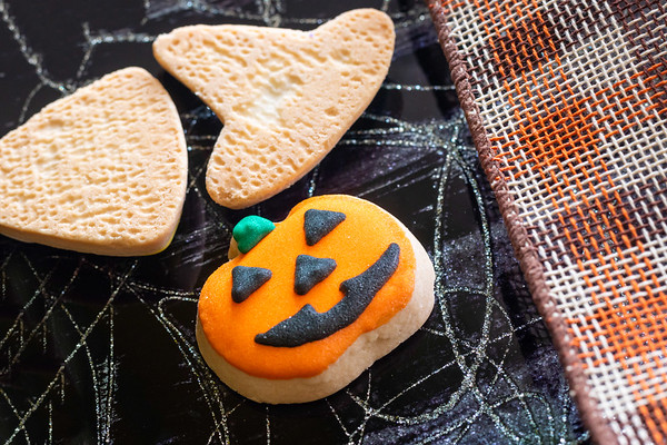Pumpkin Halloween Shortbread Cookies on a Black Plate