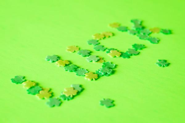 Lucky Shamrocks on a Green Background