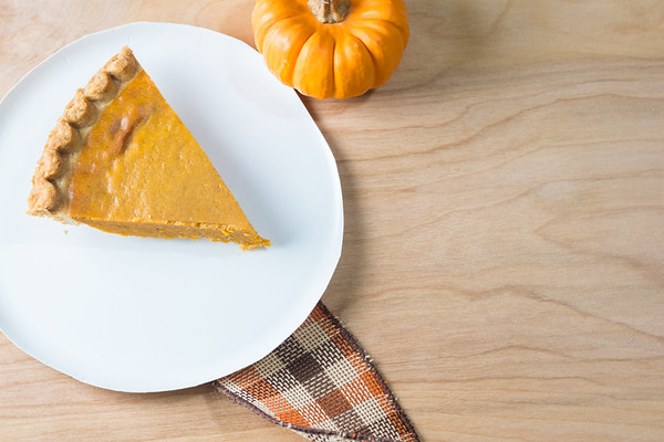 Pumpkin Pie on a Wooden Table