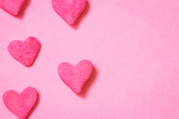 Pink Candy Hearts on a Pink Background