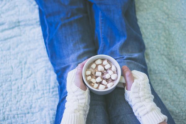 Overhead of a Woman holding a hot chocolate mug