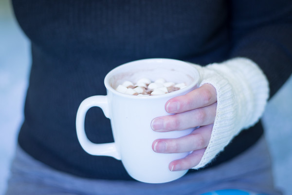 Woman holding hot chocolate in Winter