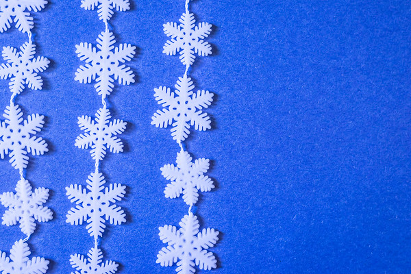 White Snowflake Pattern on a Blue Background