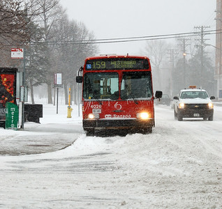 OC Transpo bus on Richmond Road at Golden Avenue in Ottawa. This is during our first winter snowstorm of the season.