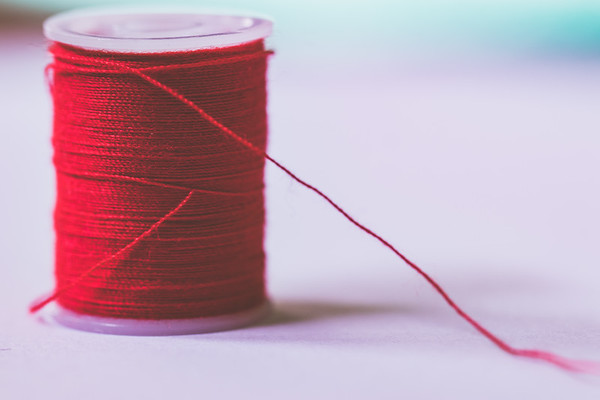 Red Thread on a White Background
