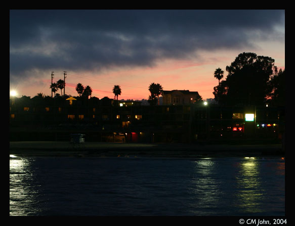 <br> <H2><b>Sunset on the wharf</b></H2> <P ALIGN=LEFT>View from the wharf towards the shore and Santa Cruz, at night.<P> <H5>(Click on picture to enlarge)</H5>