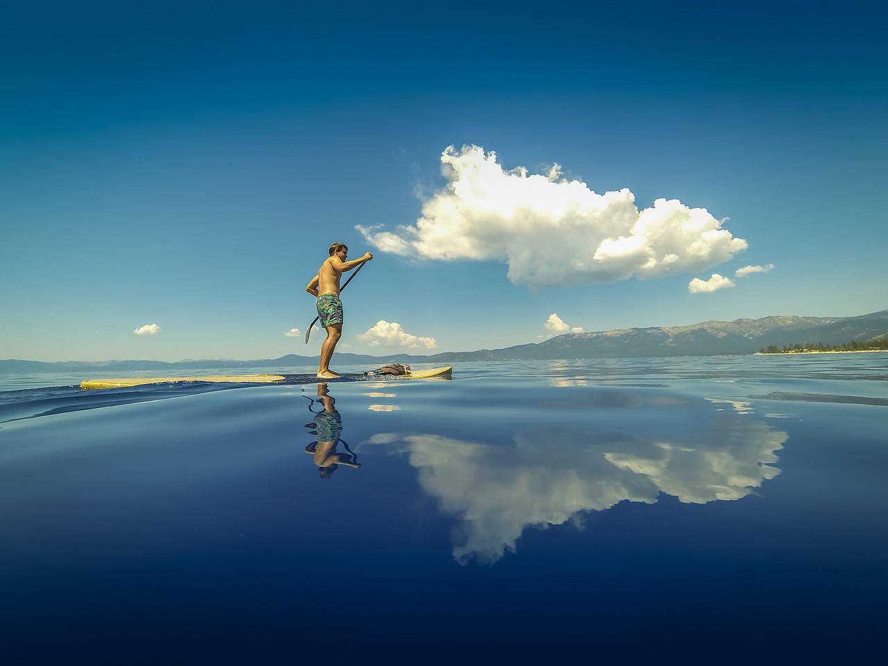 Man stand up paddle boarding near Sand Harbor, Nevada, Lake Tahoe