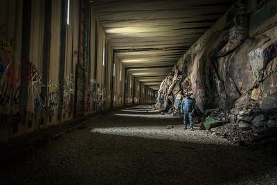 Hiker in Train Tunnels