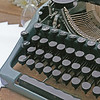 Vintage black typewriter on decorated wooden table, outdoors, close up