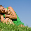 young woman or teen girl with pet cocker dog