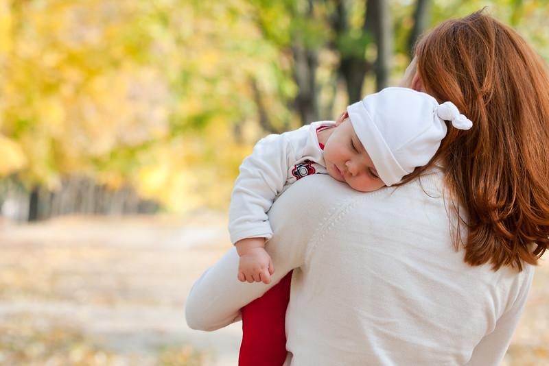 Sleeping little girl on mother's shoulder