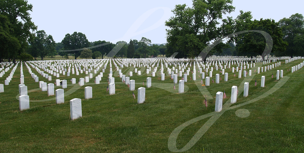 Graves in Arlington Cemetery with flags on them in Washington DC.
